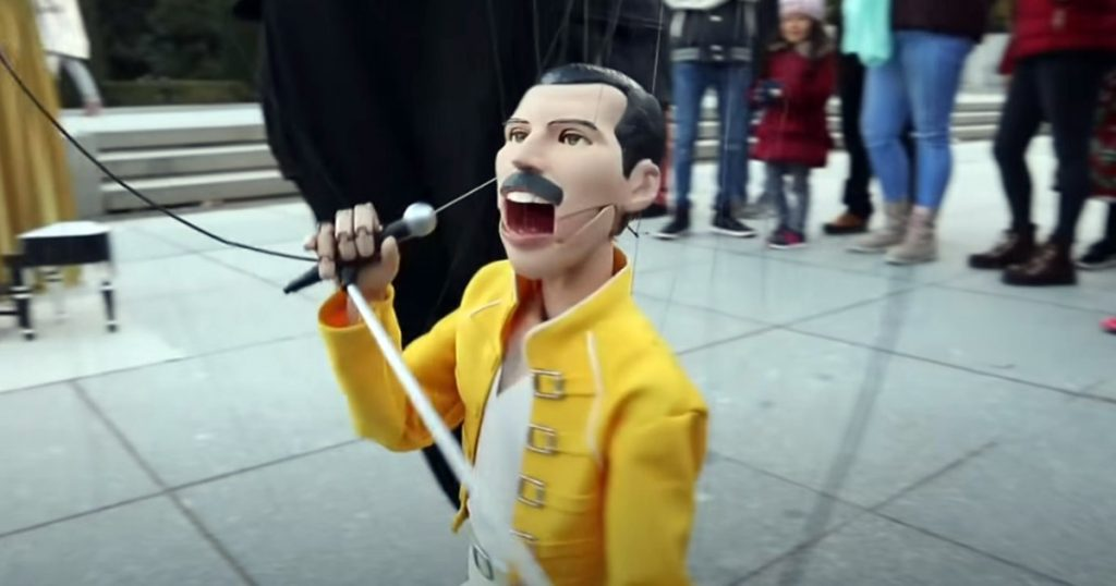 Realistic Freddie Mercury Puppet Entertains The Streets With Iconic Performance