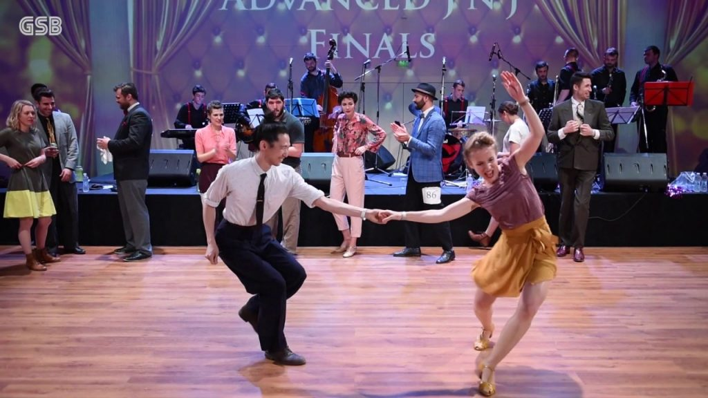 Couples Compete At A Swing Dance Festival Showcasing Their Awesome Moves