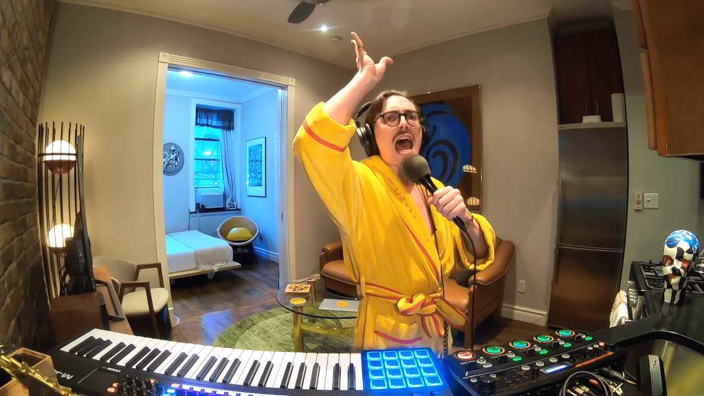 Man In Dressing Gown Improvises The Funkiest Jam In His Living Room
